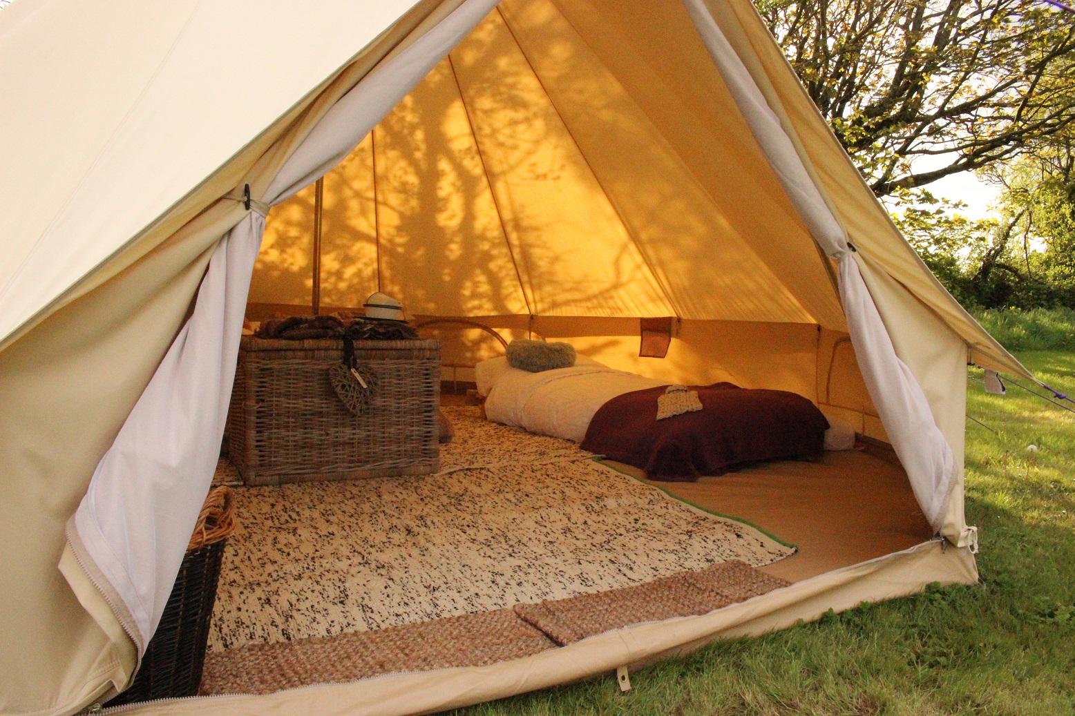 Each bell tent comes with a comfortable double futon bed and two removable singles. The beds are made ready for your arrival with all bedding blankets and ... & Bell Tent Glamping ? Stackpole Under the Stars