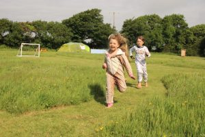 Kids can run free along our hay meadow paths and play zones