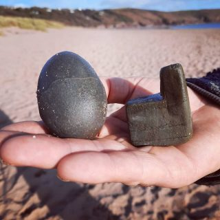 "Hands up who likes playing ""Who can find the best pebble on the beach?"" ? Dragon egg and St Govan's Chapel in the space of 5 feet. Surely unbeatable...isn't it? Show your hands, people! What have you got? #stackpolecamp #beachfinds #stgovanschapel #dragoneggs #freshwatereast #pebblybeach #pembscoast #visitpembrokeshire #takenothingbutphotos"